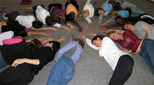 In a circle on the floor with our right arms pointing to the center