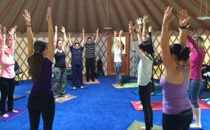 Yoga in a circle - Our arms above our heads