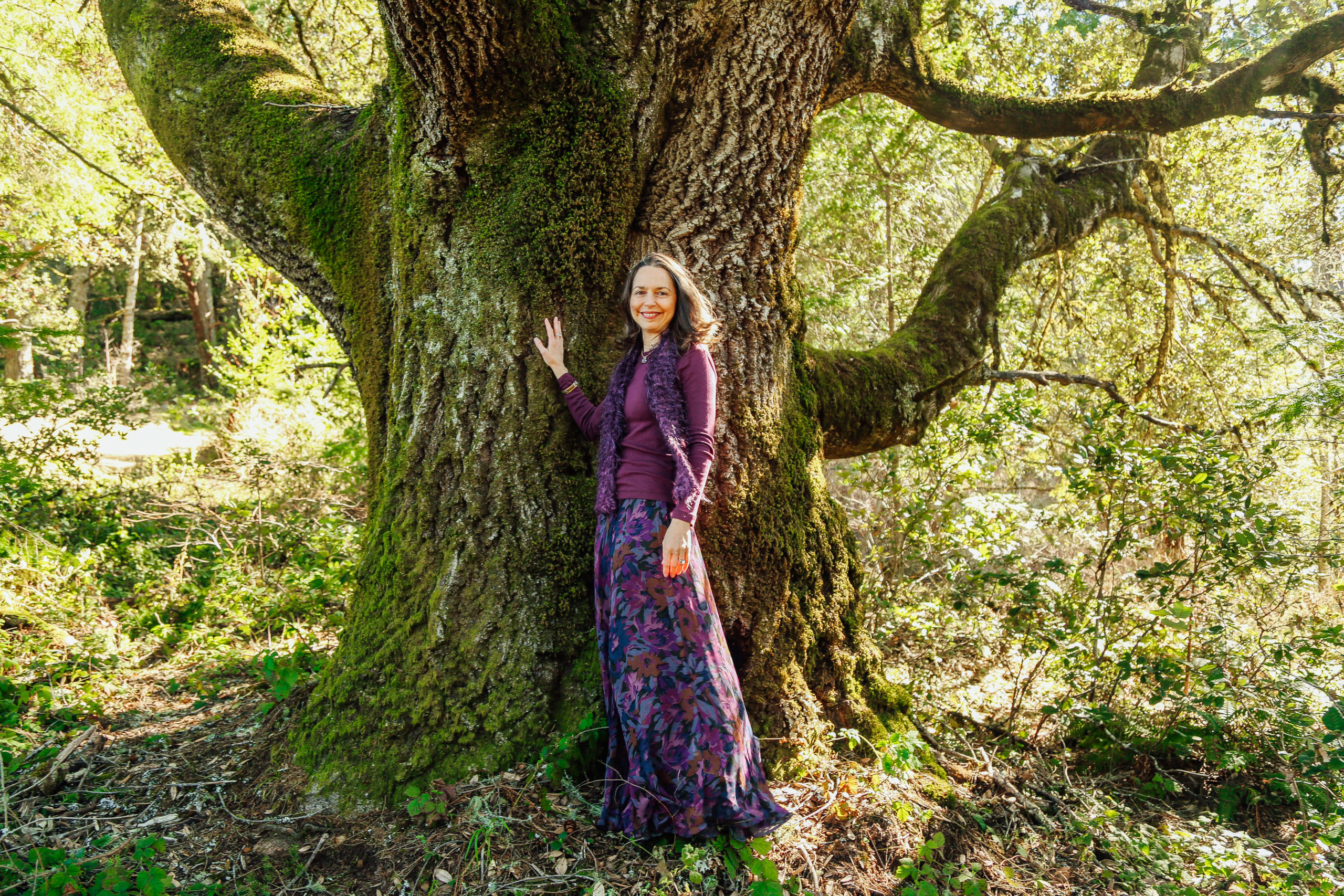Rev. Connie by a large tree - thriving in challenging times
