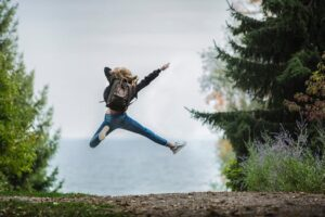 woman jumping in the air with joy