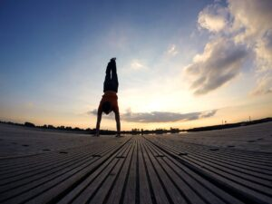 Handstand on a boardwalk