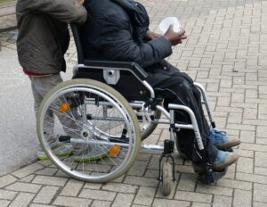 person in wheelchair holding a cup
