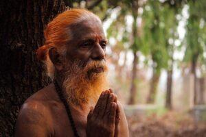 hindu saint with hands in prayer